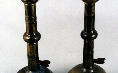 An unusual pair of Queen Anne brass ejector