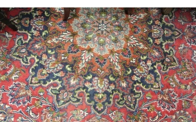 Large red ground hand woven Persian Mashad carpet traditiona...