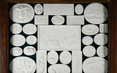 MYTHOLOGICAL SCENES.Antique natural wood frame, containing 28 plaster casts, of various shapes, representing Greek mythological scenes, including Prometheus in chains, the head of Medusa, Zeus, Diana, Dionysus, Ganymede and Zeus surrounding in the...