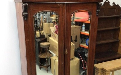 Victorian mahogany double wardrobe with two arched mirror doors and drawer below, 127cm wide x 57cm deep x 211cm high
