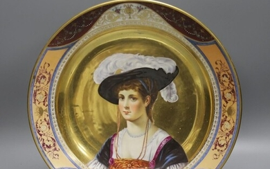 A 19th century Dresden porcelain charger, painted with a po...