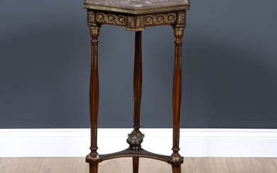 A French marble topped and ormolu mounted hexagonal walnut torchiere...