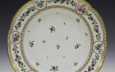 A French porcelain circular dish, late 19th century, painted to the centre with scattered floral spr