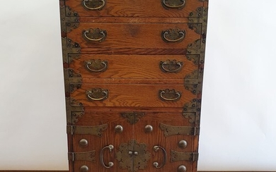 A Korean chest, having three drawers and two cupboard doors,...