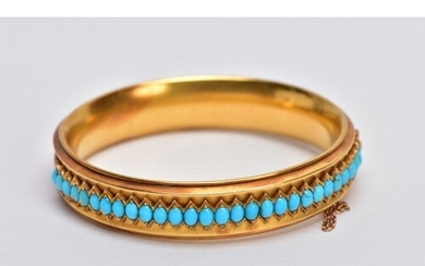 A LATE VICTORIAN TURQUOISE HINGED BANGLE, of slight concave ...