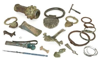 A collection of bronze and iron items, including a macehead, handles, Iron Age and later (18) Provenance: The macehead Sotheby's, May 1993; the handles ex-Horatio and Patsy Melas Collection