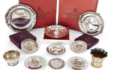 A group of silver comprising: two boxed silver plates, by Garrard & Co., Sheffield, c.1964 and 1972; both with gadrooned rims and presentation engraving, 20.4cm and 22.3cm dia.; a single-handled porringer by Garrard & Co., with applied flower motif...