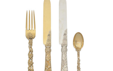 A group of silver-gilt and silver pierced vine pattern flatware