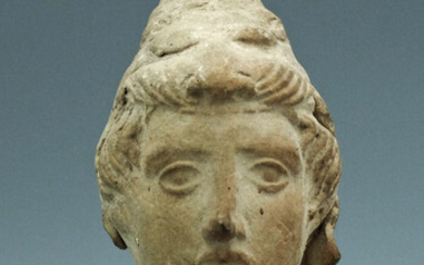 A handsome Greek terracotta head of a youth