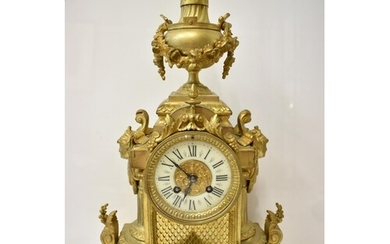 A late 19th century French gilt metal mantel clock, the case...