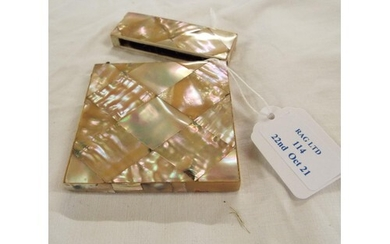 A mother of pearl and white metal star inlaid card case