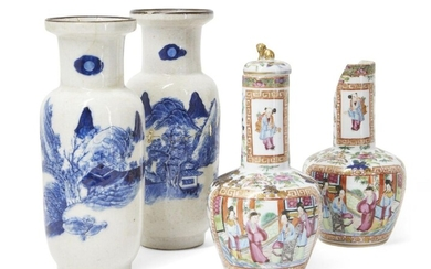 A pair of Chinese Canton export porcelain famille rose vases, late 19th century, painted with scenes of seated figures within scroll-ends borders, the exteriors decorated with flowering lotus blossoms heightened with gilt, 21.5cm high, and a pair...