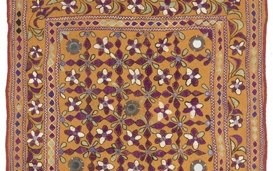 An Indian embroidered and applique hanging, Rajasthan, 19th century, densely worked in coloured silks on an orange ground, with a variety of stylized floral and other motifs and mirrors, 71 x 70cm.