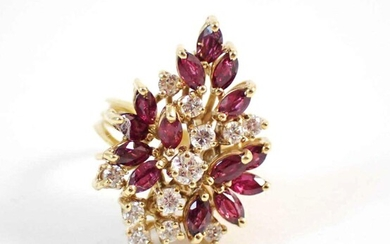 DIAMOND, RUBY AND EIGHTEEN KARAT GOLD RING, with a