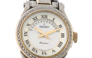NOT SOLD. Seiko: A lady's wristwatch of gold plated steel and steel. Model Premier, ref....