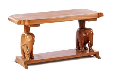 (-), Teak coffee table with harassed elephants as...