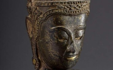 Thai Buddha head in Ayutthaya style, with remains of gilding,...