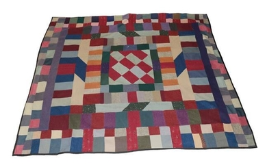 Victorian Home Spun Patchwork Bed Cover, incorporating a central block...