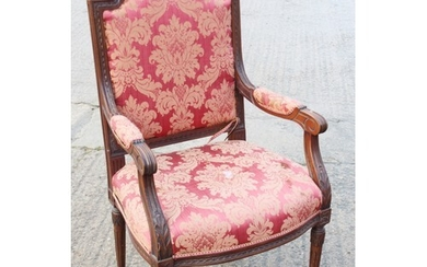A 19th century French carved walnut open armchair of Louis X...
