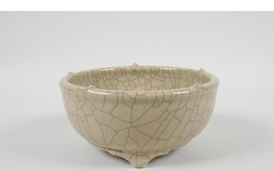A Chinese Song style crackle glazed porcelain bowl on tripod...