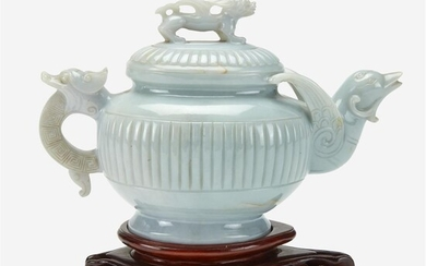 A Chinese pale greenish-white jadeite teapot and cover Finely-carved,...