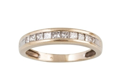 A DIAMOND HALF ETERNITY RING, the princess cut diamonds moun...