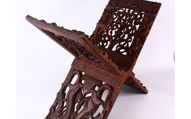 A LARGE CHINESE SIAMESE CARVED WOODEN BOOK STAND, carved wit...