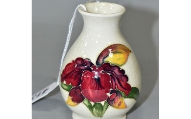 A MOORCROFT POTTERY SQUAT BALUSTER VASE, Orchid decoration o...