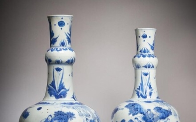 A pair of Chinese 'Seven Scholars in a Bamboo Grove' blue and white bottle vases