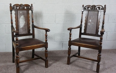 A pair of oak framed Carolean style armchairs, early 20th Century, with fretwork carved crest rails