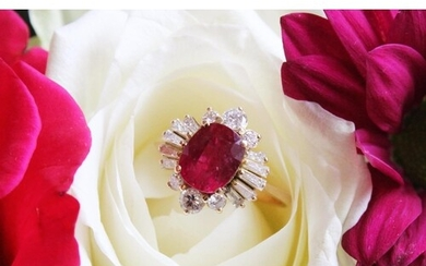 A ruby and diamond cluster ring, the central rectangular cus...