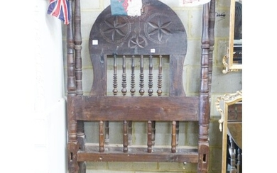 An Eastern European carved head and foot single bedstead, W....