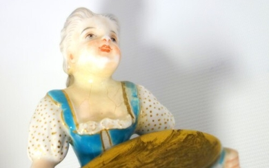 Early 20th century German porcelain figure of a boy playing ...