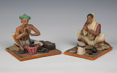 Two 20th century Indian clay figures of a seated man and woman, height 13cm, together with a painted