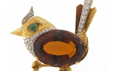 Unmarked gold and citrine bird on a branch brooch set with d...