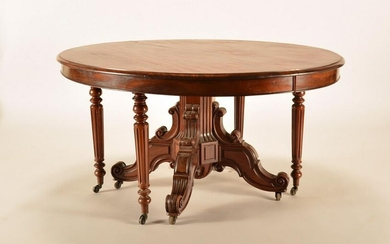 A 19TH CENTURY SOLID MAHOGANY DINING TABLE