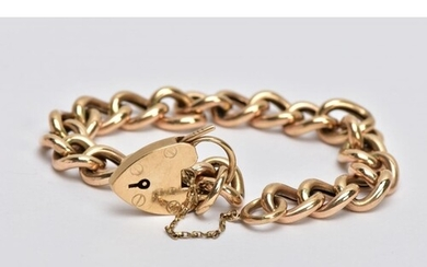 A 9CT GOLD CURB LINK BRACLET, with a heart padlock clasp and...