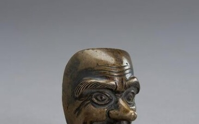 A BRONZE SCROLL WEIGHT IN THE SHAPE OF A NOH MASK