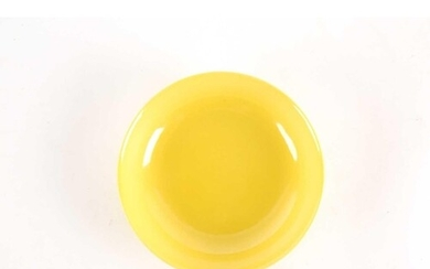 § A Chinese monochrome yellow dish, with shallow sides, on a...
