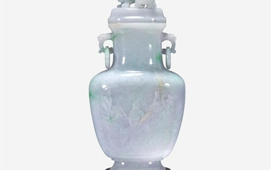 A Chinese pale green, lavender and white jadeite vase...