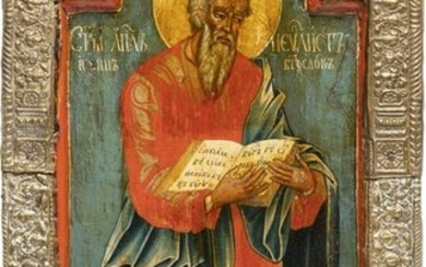 A FRAGMENT OF AN ICON SHOWING ST. JOHN THE EVANGELIST