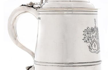 A George III silver tankard, of tapered form with ogee domed...