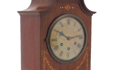 A German inlaid mahogany cased eight-day chiming mantel clock by Gustav Becker, early 20th century, decorated with a harebell swag beneath a brass dial set with Roman numerals, on brass bracket feet, 41cm Please note Roseberys do not guarantee the...