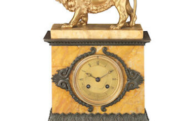 A Louis Philippe gilt and patinated bronze and Sienna marble mantel clock