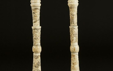 A Pair of Japanese Carved Bone 'Figural' Candlesticks
