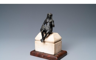 A black-patinated bronze figure of a young lady wearing a lo...