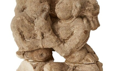 A carved sandstone fragment of a couple, possibly Satavahana, India, the woman playfully tugging her lover's beard, repaired, 24cm. high Provenance: Formerly in the Private Collection of Werner Forman (1921-2010)