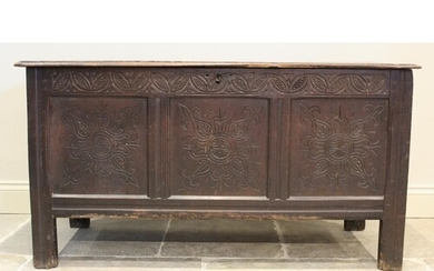 A late 17th/early 18th century oak coffer, the twin plank mo...