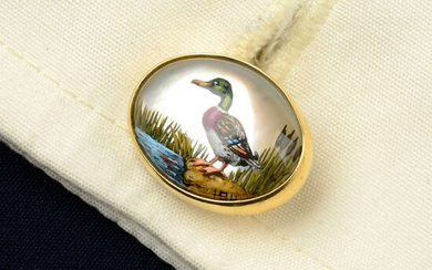 A pair of 18ct gold reverse-carved and painted rock crystal cufflinks, depicting a mallard duck and pheasant, by Deakin & Francis.