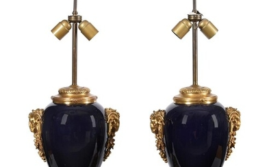 A pair of blue porcelain and gilt metal mounted table lamps